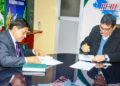 Martin Ticona y Julver Vilca firmaron convenio institucional.